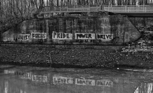 canal footbridge graffiti