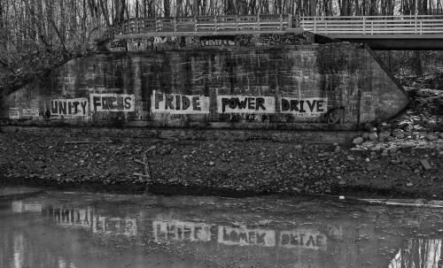 canal footbridge graffiti