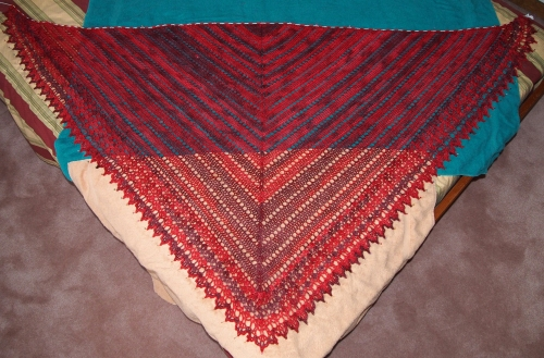 crochet shawl - blocking on bed