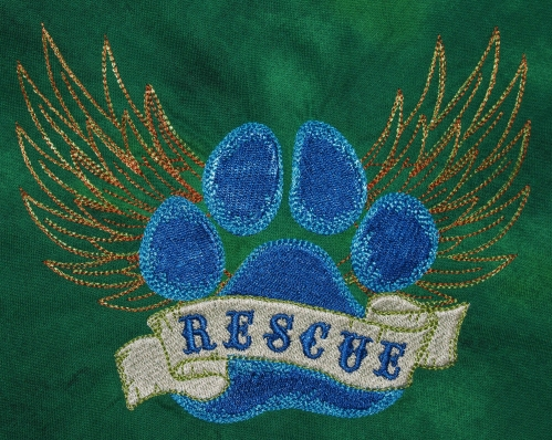 Rescue embroidery on green - detail
