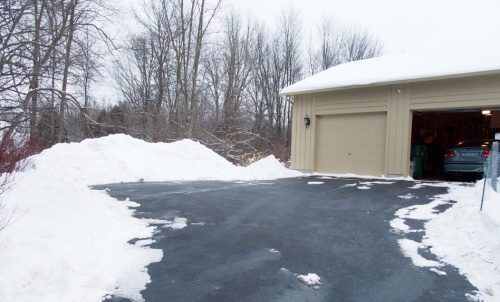 Snow pile next to garage