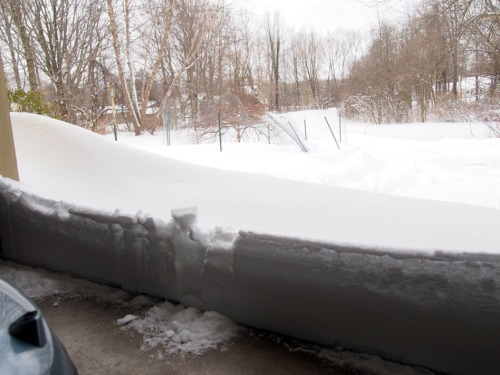 Snow drift in front of garage