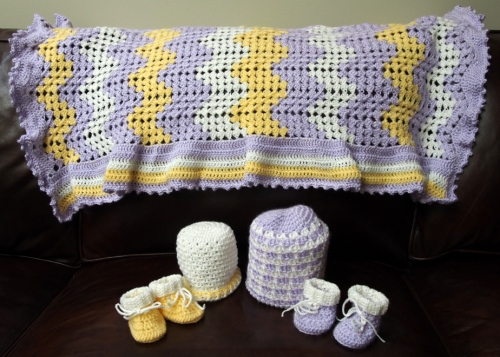 Crochet baby blanket, hats and booties