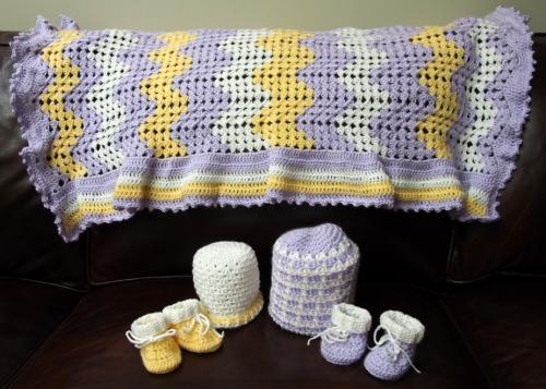 Crochet baby blanket, hats and booties