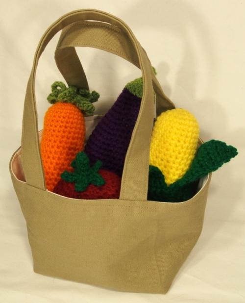 veggie rattles in tote bag